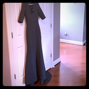 bebe drk green gown tags still on, excellent cond.